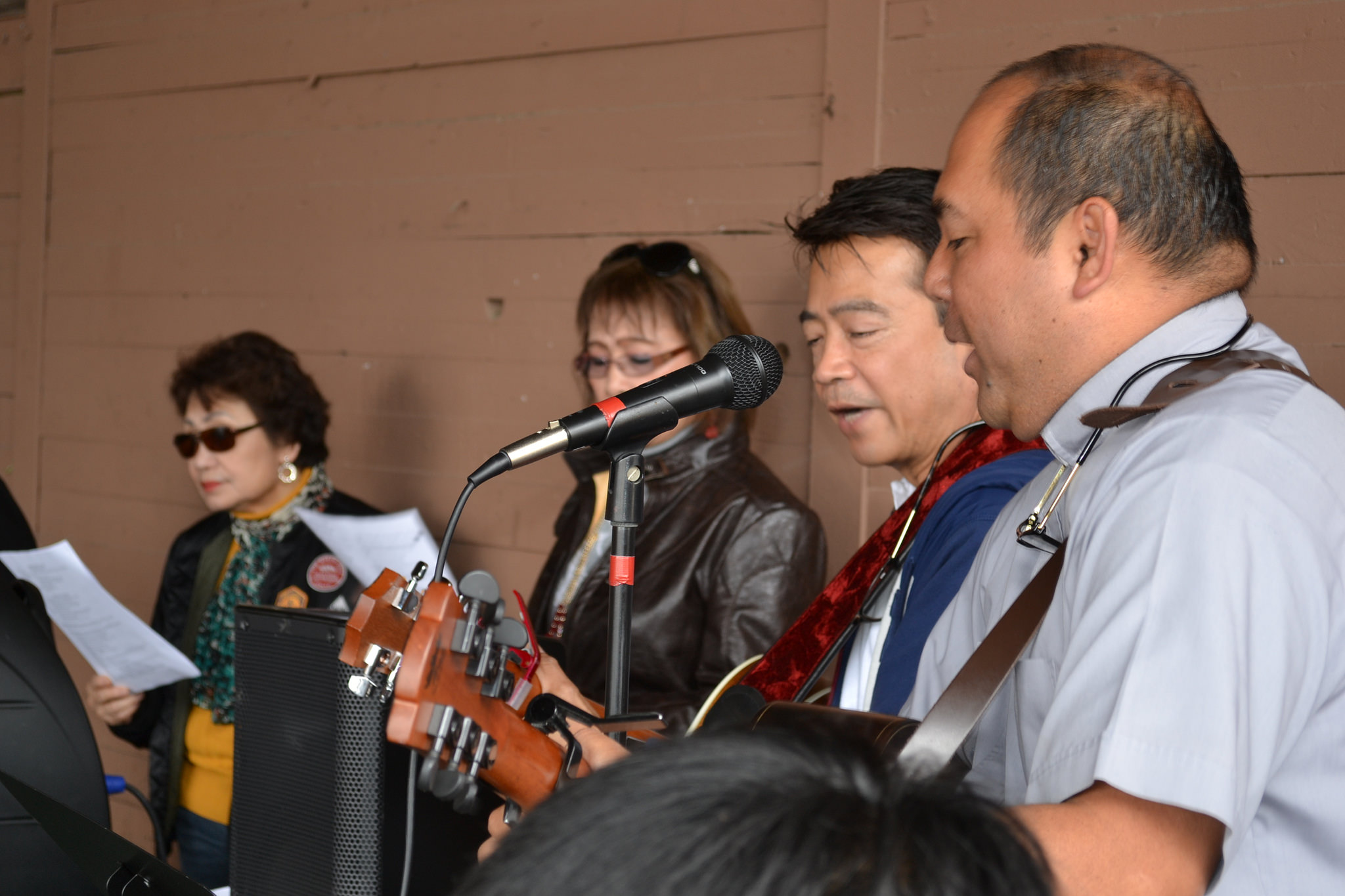 Rev. Leonard Oakes on guitar singing with HCSM choir members