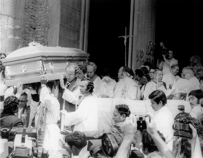 Priests carry Archbishop Romero's coffin out of the Metropolitan Cathedral of San Salvador, March 30, 1980.